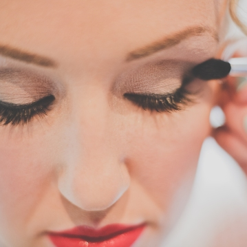 Classic bridal makeup with red lip; defined eyes, flawless skin.